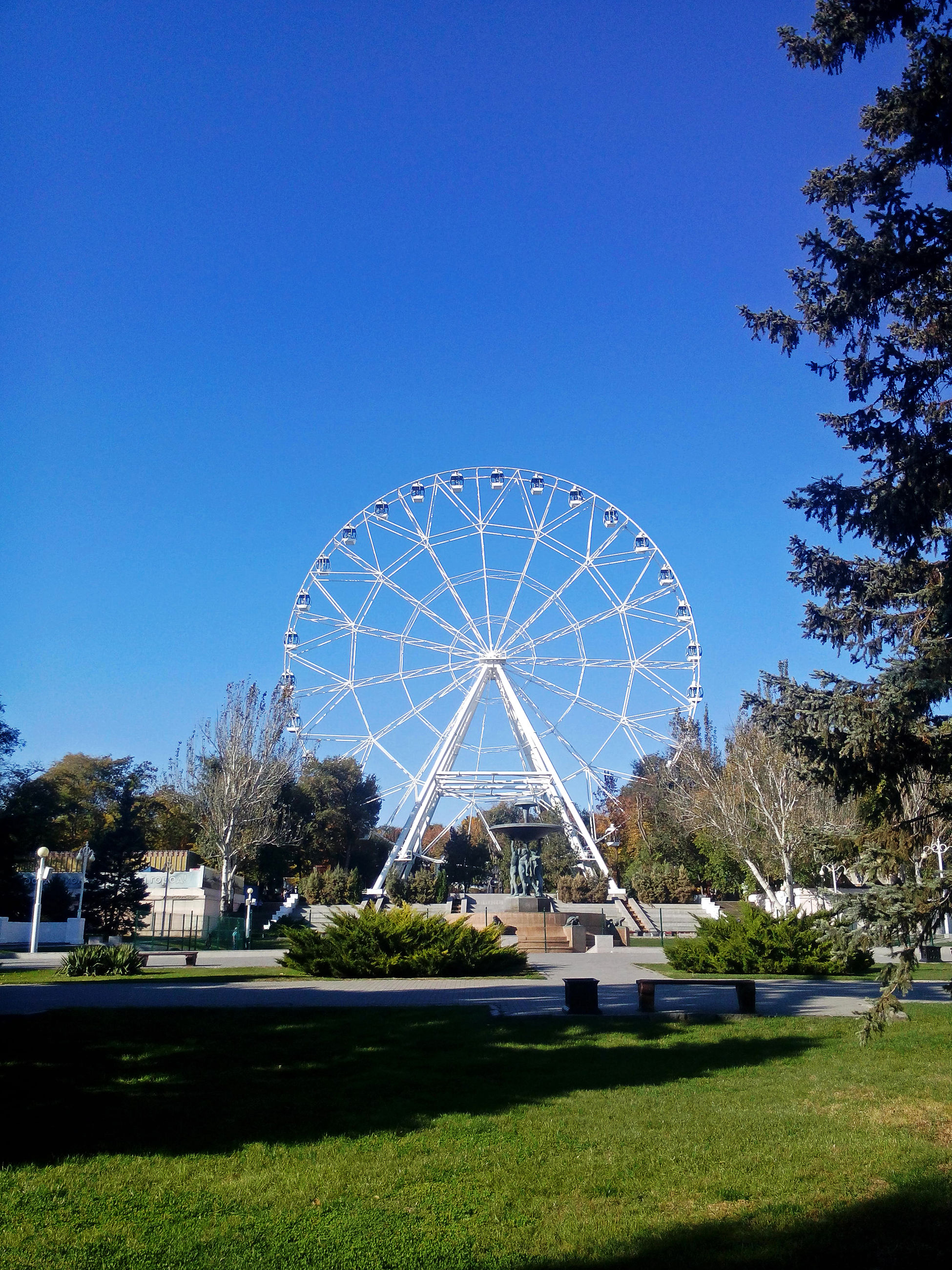 blue, sky, clear sky, outdoors, amusement park, tree, no people, ferris wheel, nature, architecture, day, astronomy