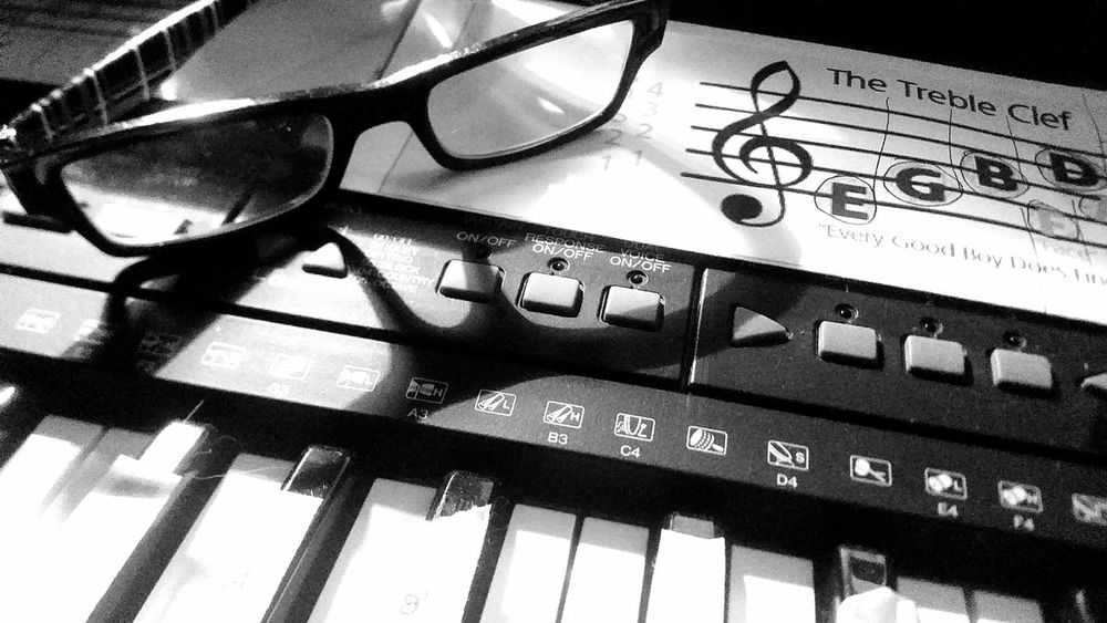Focus Indoors  Close-up Music Musical Instrument Music Is Life Keyboard Instrument Sheet Music Learning Piano Piano Keyboard  Piano Lessons Piano Practice Pianokeys Reading Glasses
