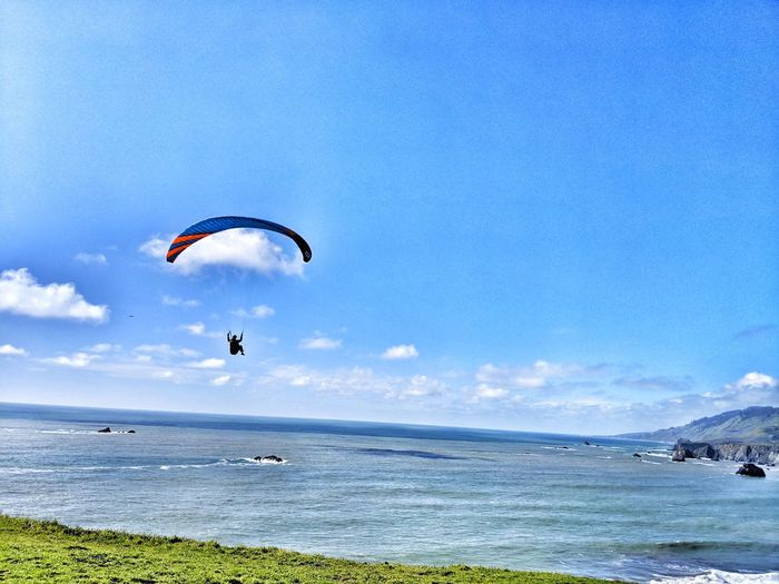 Paragliding. From cliffs edge. Over the ocean. Paragliding Paraglider Thrill Sport Dangerous Hang Windy Edge Cliff Jump Background Ocean Peaceful Therapeutic Paragliding Parachute Extreme Sports Water Flying Sea Beach Adventure Mid-air Sport Gliding Surf Rushing Exhilaration Skydiving Wave