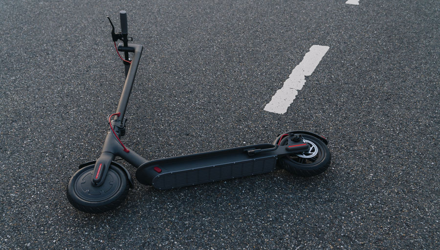 High angle view of push scooter on road