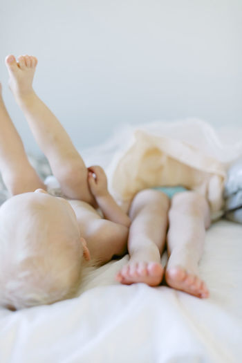 Close-up of baby lying on bed