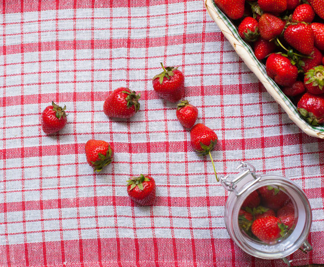 Top view of basket and glass bowl with fresh delisious strawberries on the tablecloth Berry Fruit Bowl Close-up Day Directly Above Food Food And Drink Freshness Fruit Healthy Eating Healthy Lifestyle Indoors  No People Quilt Red Strawberry Summer Tablecloth