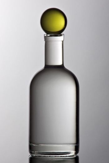 Close-up of beer bottle against white background