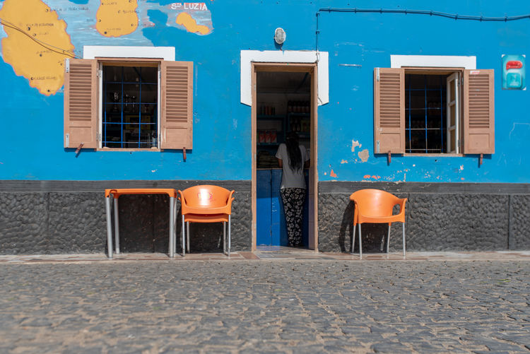 Hoffi99 Day Building Exterior Architecture Built Structure Building Window No People Blue City Seat Nature Residential District Street House Outdoors Sunlight Chair Shadow Absence Restaurant