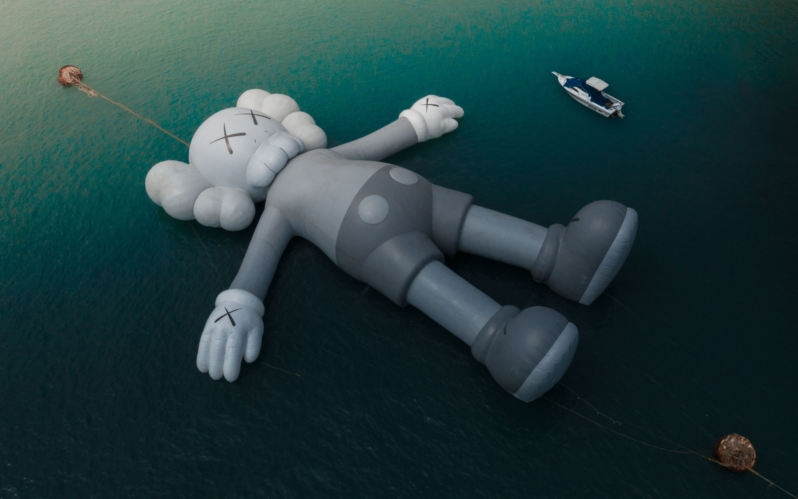 water, high angle view, nautical vessel, representation, sea, transportation, toy, human representation, mode of transportation, nature, real people, waterfront, day, people, art and craft, leisure activity, floating, figurine, floating on water, inflatable