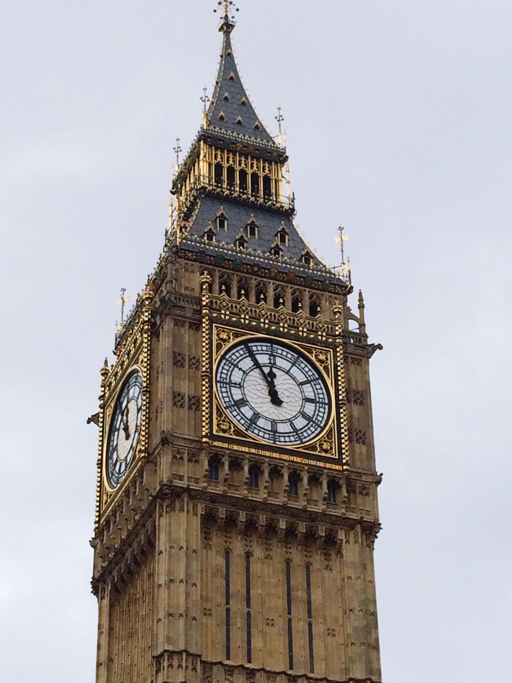 architecture, low angle view, clock, clock tower, built structure, tower, building exterior, time, tall - high, clear sky, famous place, travel destinations, international landmark, history, capital cities, big ben, sky, tourism, travel, religion