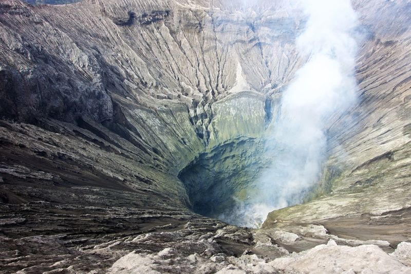 Volcanoes Beauty In Nature Bromo Crater Day Environment Formation Geology Land Landscape Mountain Nature No People Non-urban Scene Outdoors Physical Geography Power In Nature Rock Rock - Object Rock Formation Scenics - Nature Smoke - Physical Structure Solid Volcanic Crater Volcano