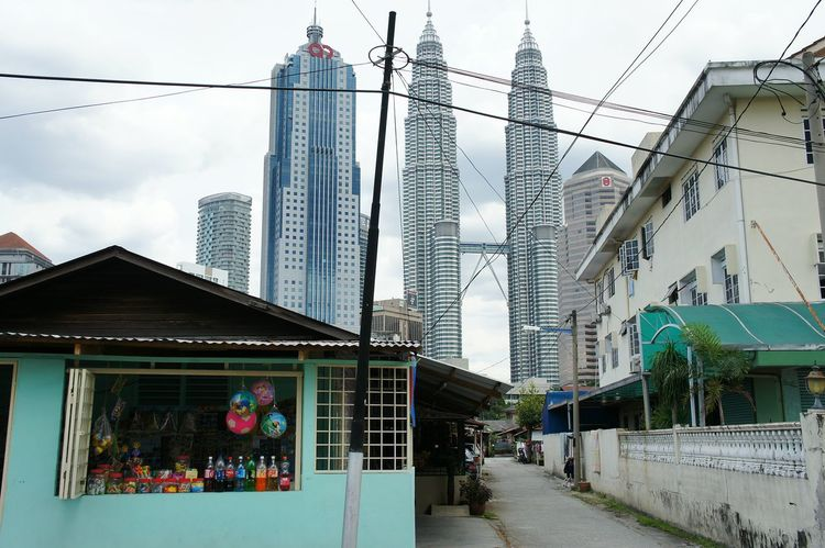 View of Petronas Twin Towers from Kampung Baru Kuala Lumpur Kualalumpur Malaysia EyeEm Malaysia Petronas Twin Towers Twin Towers Klcc Tower Kuala Lumpur City Center Oldmeetsnew New Meets Old Old Meets New Modern Traditional Culture Malaysian Architecture Architecture_collection Gettylicious Stockphoto Travel Photography City Cityscape Urbanscape Wanderlust