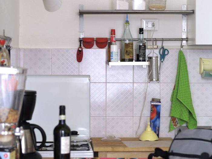 Gas Stove Burner And Bottles In Kitchen At Home