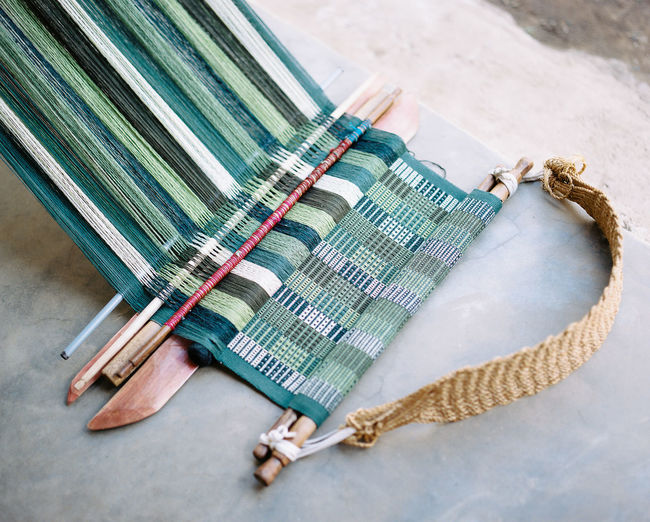 High angle view of mat being weaved on floor