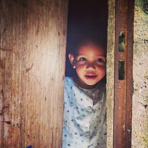 Peek-a-boo. One of the Rocinha favela children I managed to capture on my camera. This one being my favourite. Riodejaneiro
