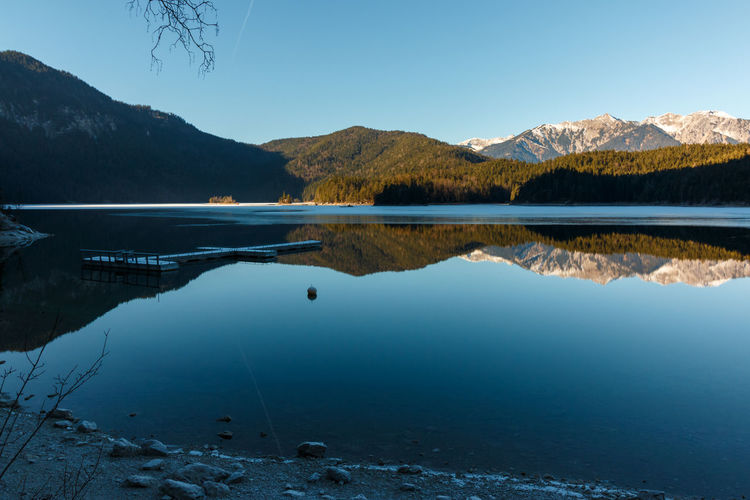 Bavaria Eibsee on the Zugspitze Berge Eibsee Beauty In Nature Blue Clear Sky Day Idyllic Lake Mountain Mountain Range Nature No People Non-urban Scene Outdoors Reflection Remote Scenics - Nature See Sky Tranquil Scene Tranquility Water Waterfront