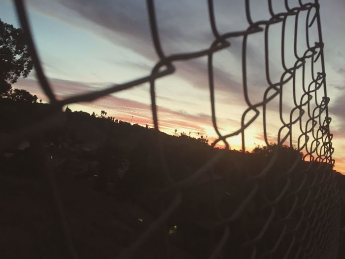 Chainlink Fence Sunset Protection Safety Security Sky Silhouette No People Outdoors Nature Day Close-up Beauty In Nature