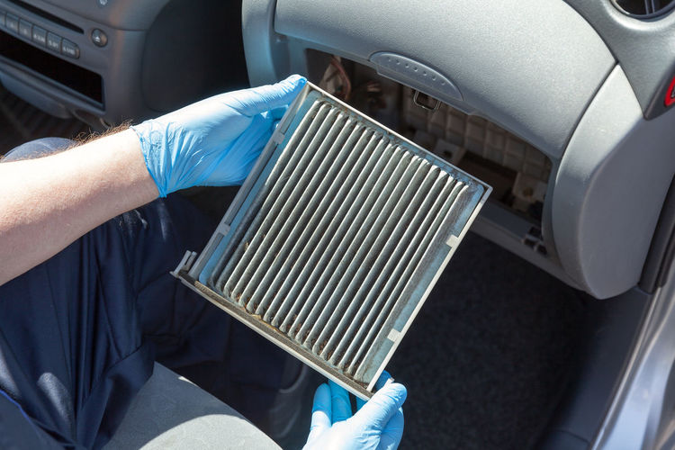 Replacing the old cabin air filter Air Conditioner Automobile Filter Mechanic Spare Part Transportation Air Filter Automotive Automotive Cabin Air Filter Cabin Air Filter Car Car Air Filter Car Service Dirty Dust Health Holding Human Hand Maintain Maintenance Work Old Protective Glove Replacement Vehicle Working