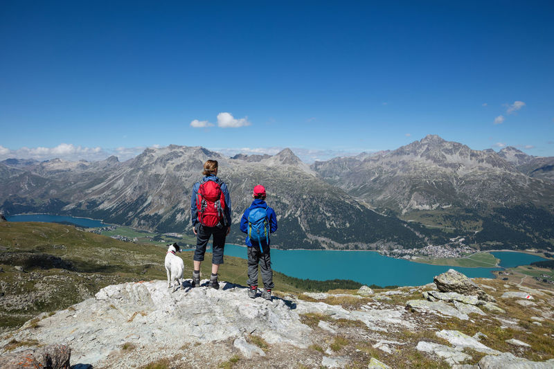 View at lake Silvaplana, Engadin, Switzerland. Adventure Beauty In Nature Blue Casual Clothing Child Engadin Hiking Idyllic Landscape Lifestyles Mother Mountain Mountain Range Nature Non-urban Scene Rock - Object Season  Silvaplana Silvaplana Lake Sky Switzerland Tranquil Scene Tranquility Vacations Woman