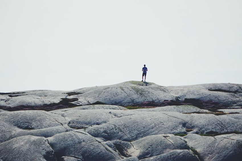 one person walking on the rocks Minimalism Adventure Rock - Object Rock Formation Full Length Adventure Hiking Men Standing Hiker Backpack Arid Landscape Arid Climate Coast Rocky Mountains Shore The Great Outdoors - 2018 EyeEm Awards