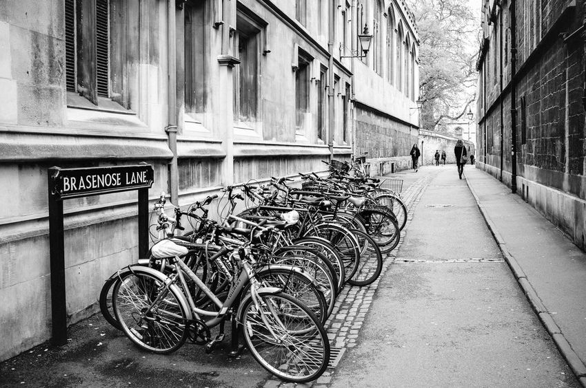 Alley Architecture Bicycle Building Building Exterior Built Structure City Day Direction Eye4black&white  Eye4photography  Footpath Incidental People Land Vehicle Mode Of Transportation Outdoors Real People Shootermag Stationary Street Text The Way Forward Transportation Wall - Building Feature Wheel