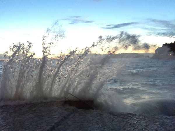 Sparkling Wave Beach Nature Outdoors Power In Nature Scum Sea Sky Sunset Water