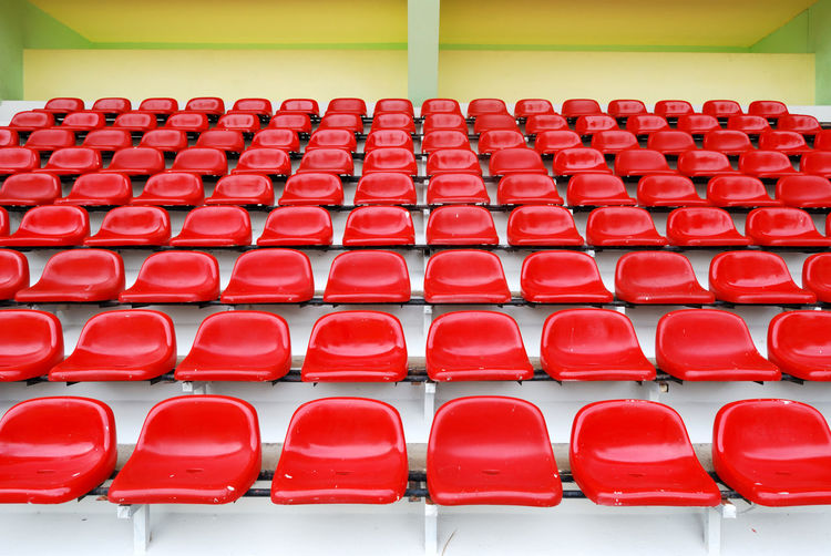Red bleachers in sport stadium