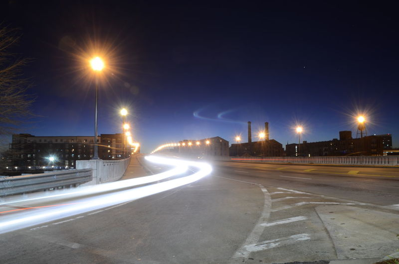 Illuminated Street Road Night Street Light City Transportation Architecture Long Exposure Light Trail No People Building Exterior Lighting Equipment Motion Direction Nature The Way Forward Built Structure Sky Symbol Outdoors Light My Best Photo 17.62°