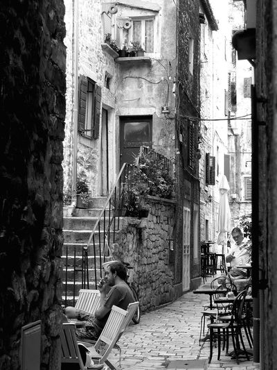 Arch Architecture Built Structure Street Photography Streetphotography Perspective People Watching People People Photography Outdoor Photography Black And White Photography Blackandwhite Photography Black & White Black And White Bnw Blackandwhite Calm RelaxingCity Life City Residential Building Atmospheric Mood Ambiance Peoplephotography Alleyw Hvar, Croatia