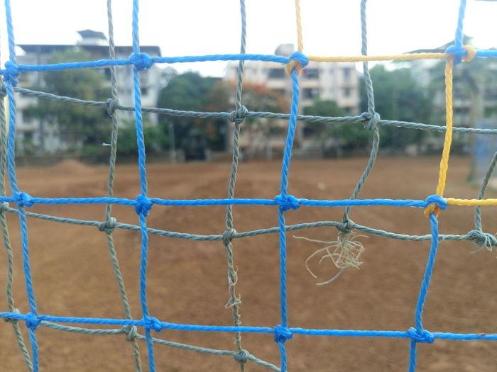 Full frame shot of net at soccer field