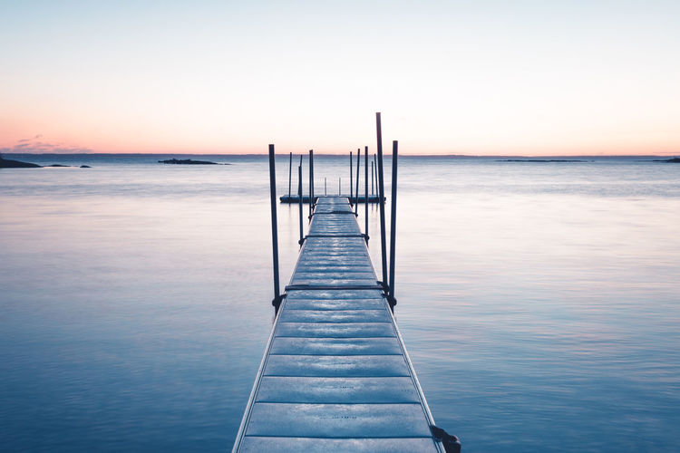 Left or right? Sea Horizon Over Water Water Sunset Pier Scenics Tranquil Scene Beach Sky Tranquility Landscape Beauty In Nature Wood - Material Idyllic Jetty Sunlight Blue Clear Sky Sun Outdoors Nature Low Angle View Pentax Sweden Serenity