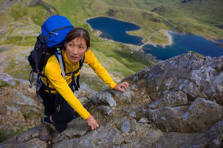 High angle portrait of woman on rock