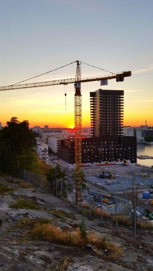 Construction work skyscraper building crane sunset silhouette horizon sjövikskajen Stockholm South expansion golden moments
