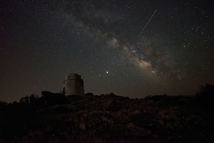 Milky way over an old watchtower
