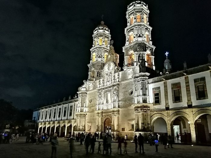 Low angle view of historical building at night