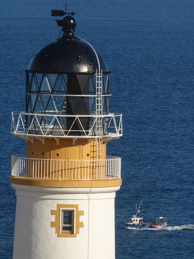 Tiumpan Head Lighthouse Fishing Boat Fishing Hebrides Scotland Lighthouse Sea Water Architecture Nautical Vessel Built Structure Building Exterior Blue Horizon Over Water Dome No People Day Lighthouse Outdoors Sky