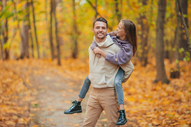Young couple in park during autumn