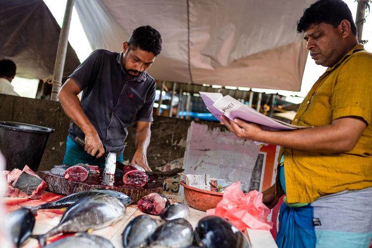 Friends standing in market