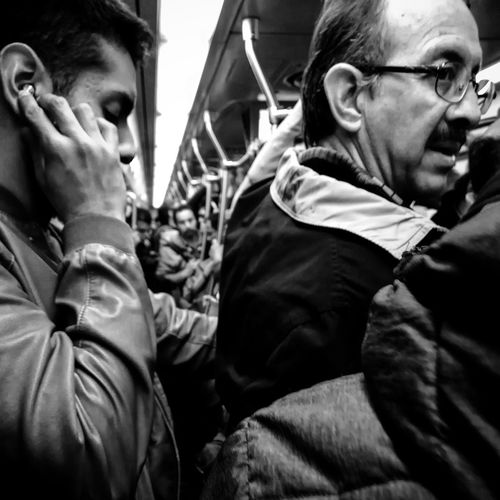 #2018 Subterranean Metro Subway Subway Train Music Headphones Night Guy Man Amateur Photography Photo Photooftheday Only Men Men Adult Adults Only People Social Issues Eyeglasses  Community Outreach Mobility In Mega Cities