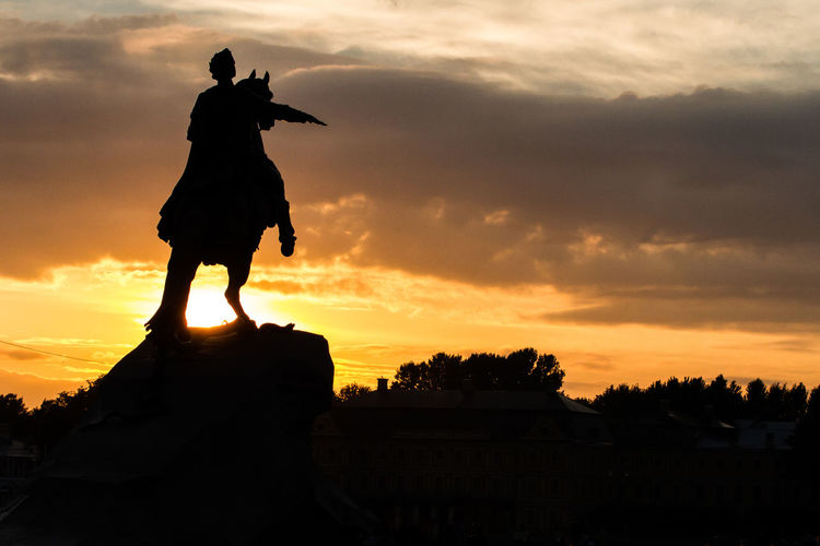 Formidable rider Peter The Great Cloud - Sky Color Lights Fearsome Monument Orange Color Powerful Feelings Silhouette Sunset
