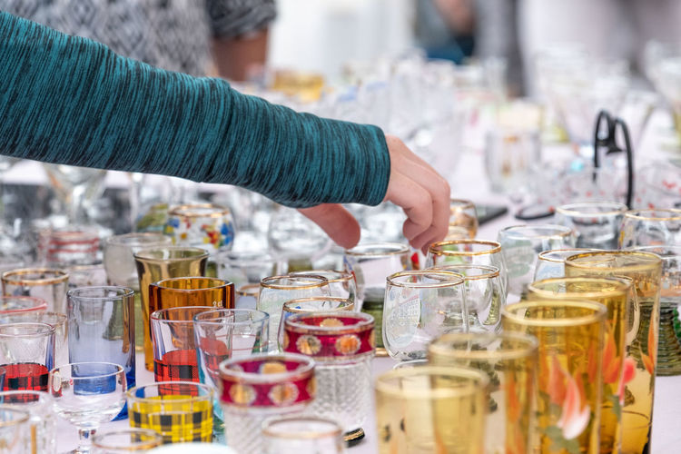 Old-fashioned Abundance Adult Business Choice Choosing Close-up Consumerism Flea Market Focus On Foreground Glass Glass - Material Hand Human Body Part Human Hand Large Group Of Objects Nostalgia One Person Outdoors Real People Retail  Selective Focus Store Used Variation