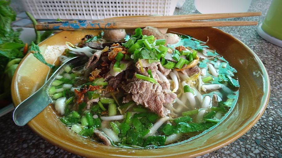 High Angle View Of Beef Soup Noodles Served In Bowl