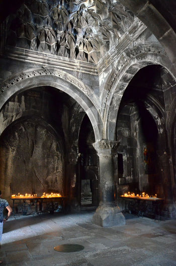 Armenia Armenian Church Geghard Geghard Monastery Altar Arch Architecture Building Exterior Built Structure Burning History Illuminated Indoors  Night No People Oriental Orthodox Church Place Of Worship Religion Sculpture Spirituality W-armenien