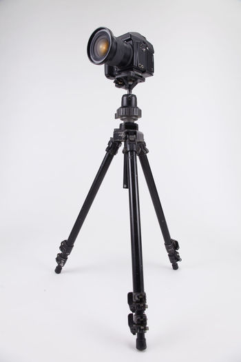 studio shot of high end digital camera on the tripod Camera Photography Multimedia Expertise Professional Occupation Tripod Photograph DSLR Lens Equipment Photographic Theme Photographing Black Nobody White Background Medium Format Camera Photography Themes Technology Studio Shot Camera - Photographic Equipment Indoors  No People Still Life Photographic Equipment Close-up Digital Camera Copy Space Single Object High End Medium Format Activity Film Industry Gray Background Filming
