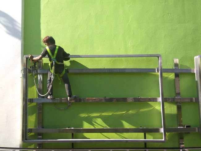 Green Color One Person Full Length One Man Only Worker Eyeem Philippines Mobile Photography Kulotitayclicks Mobileglobalshooters Green Color Wall Jobtime Working Hard