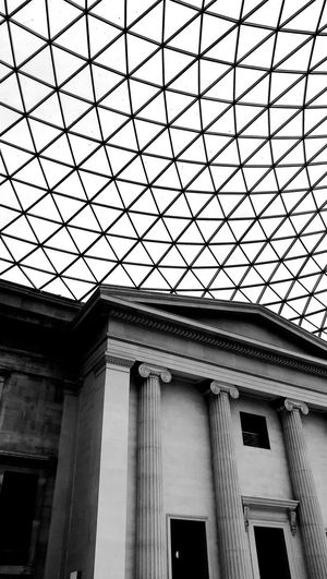 A grid for the ancient Architecture Window Low Angle View No People Indoors  Blackandwhite Sculpture EyeEm LOST IN London EyeEmNewHere Londonlife B&w