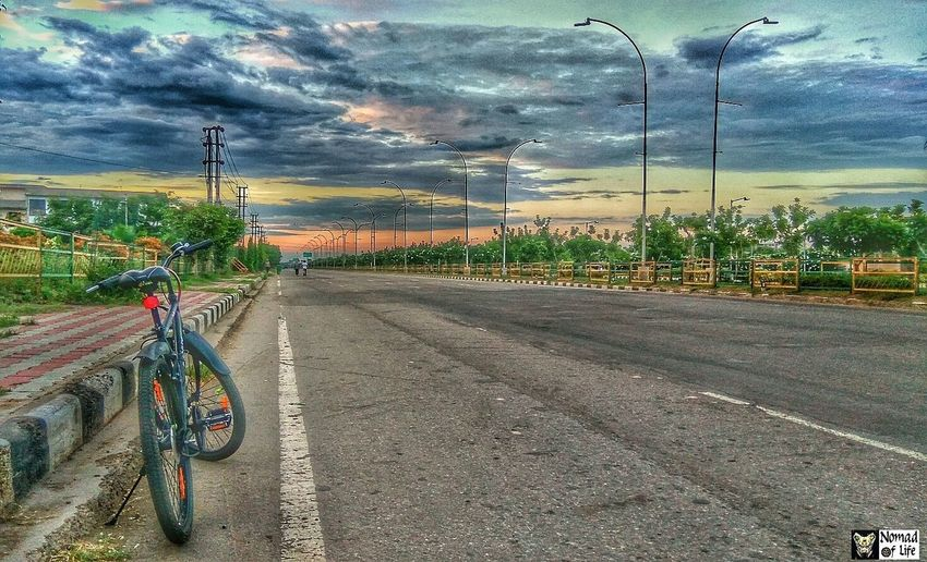 Exploring around Chandigarh on my cycle 🇮🇳 Highwayphotography People Cityscape Clouds And Sky Traffic Lights Architecture Outdoors Mode Of Transport Transportation Landscape Beauty In Nature Cloud - Sky Dramatic Sky Nature Freshness Multi Colored Sunrise_Collection High Angle View Cycle Cloudscape Blue Scenics Travelgram No People Colour Your Horizn