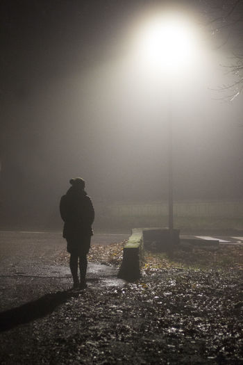 Fog Full Length Lifestyles Men Nature Night One Person Outdoors People Real People Rear View Silhouette Sky Standing Women