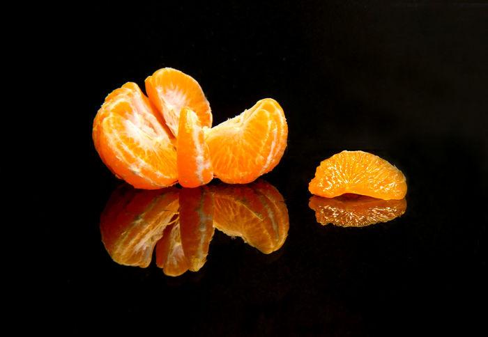 Tangerine with reflection on the black background Black Background Citrus Fruit Close-up Food Freshness Fruit Healthy Eating Mandarin No People Orange - Fruit Orange Color Studio Shot Tangerine