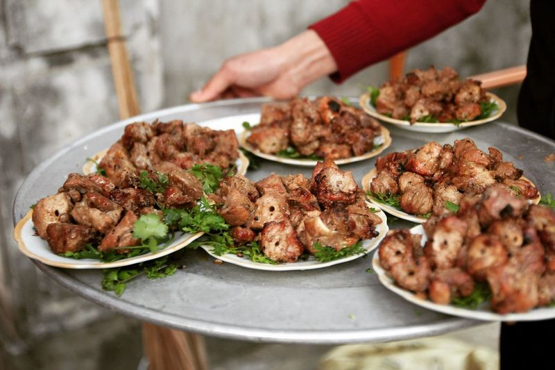 Close-Up Of Cooked Pork On  Plates