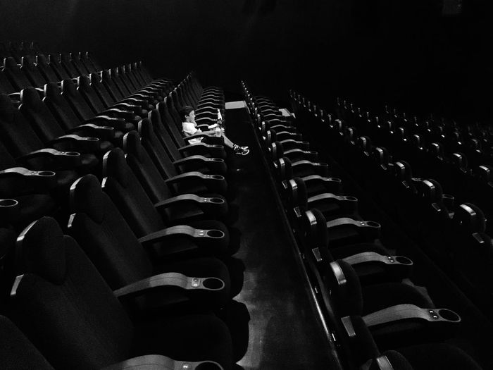 Movie theatre' s best seat waiting for the show. Quite Moments Black & White In A Row Repetition Chair No People Seat Side By Side Auditorium Movie Theater Empty High Angle View Absence