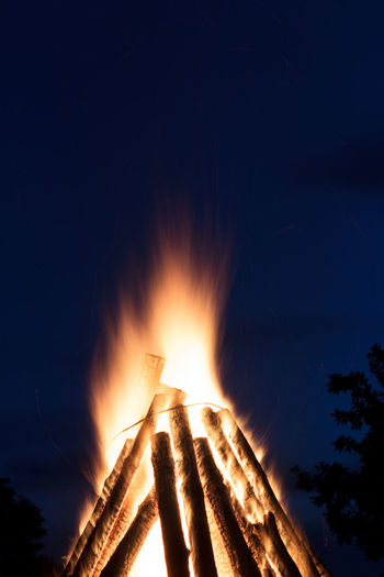 Low angle view of bonfire against sky at night