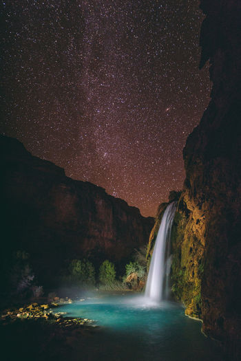 What Havasupai people saw in fall night sky | I hiked up to Havasu Falls, where it felt like more stars came out in the sky. Being far enough from the campground and yet still surrounded by the tall canyon walls, let alone being in one of the least polluted parts of the country, really increased the visibility of the stars with my bare eye. Facing northeast, I captured the typical north tip of the Milky Way along with Cassiopeia that rose above Havasu Falls. Because it was late September, I was expected to be able to see the Andromeda galaxy (in fall, and best in November). And there it was - M31, our neighboring galaxy. It is a bit misleading though because the galaxy, 4 billion years younger than our own, is technically 2.537 million light years away. Wondered what the Havasupai people saw in the fall night sky over the span of at least 800 years of their occupancy across the Grand Canyon. Supai, AZ Andromeda Galaxy Astronomy Astrophotography Beauty In Nature Constellation Galaxy Havasu Falls Havasupai Landscape Light Painting Milky Way Nature Night Night Photography No People Outdoors Sky Solitude Space Space And Astronomy Stargazing Stars Supai, AZ Water Waterfall