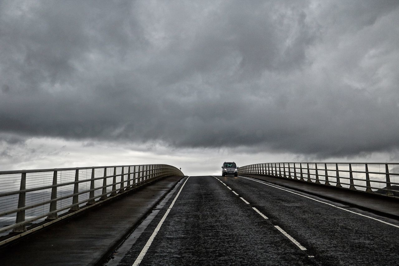 weather, sky, cloud - sky, railing, sea, transportation, road, outdoors, storm cloud, day, nature, the way forward, water, no people, bridge - man made structure, scenics, beauty in nature, horizon over water